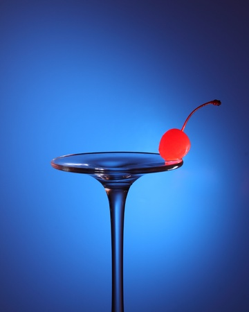 Cherry balancing on the edge of an inverted wine glass