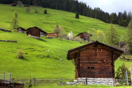scenary: old barn along the foot hills of Alps Stock Photo