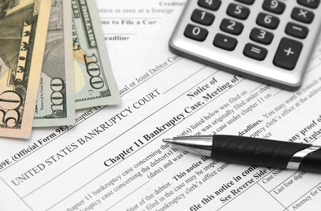 Bankruptcy form with money and calculator