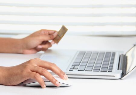 online purchase: Making online purchase on a laptop using a credit card Stock Photo