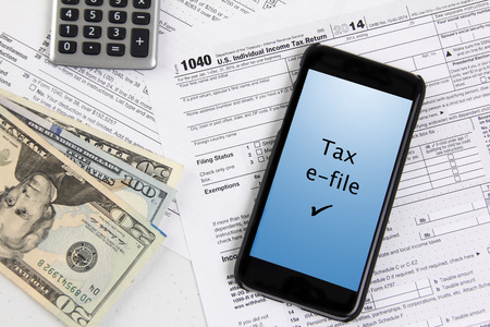 e-file taxes with mobile phone Stock Photo