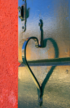 Shadow of a door handle forming a valentine heart shape