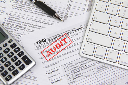 financial audit: Filing taxes online using a computer and being audited Stock Photo