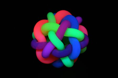 rubber ball: Rubber ball under black light Stock Photo