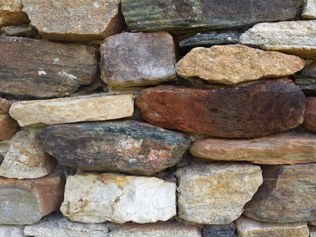 Stone wall pattern from old log cabin chimney