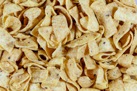 extrusion: Close up of fried corn chips Stock Photo