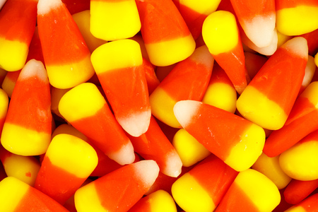 candy corn: A closeup pile of colorful Halloween candy corn Stock Photo