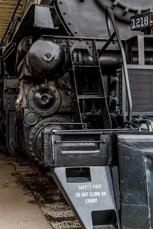 Close up steam powered locomotive.