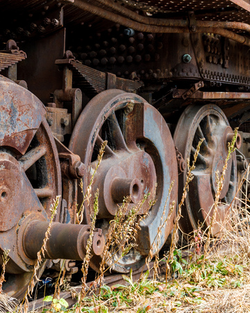 Close up wheels on abandoned steam powered locomotive