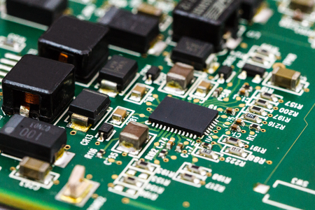 Printed circuit board with ICs, chip capacitors, and chip resistors. Banco de Imagens
