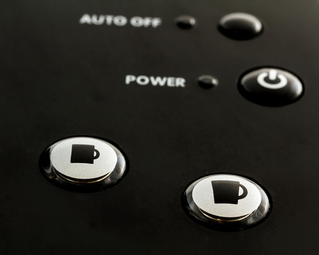 Close up of buttons on single serve coffee and tea maker.