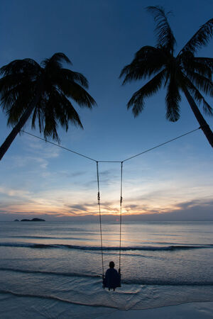 swing with sea sunset photo