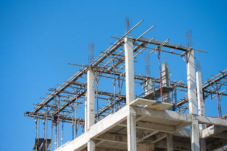 Building construction site work against blue sky Foto de archivo