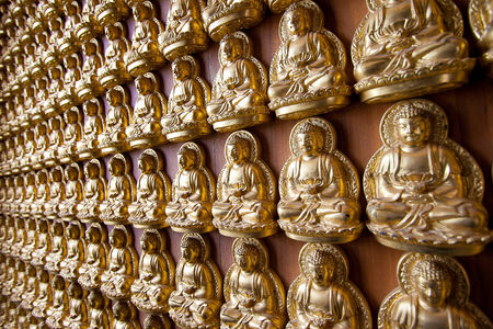 buddha on wall in chinese temple Thailand photo