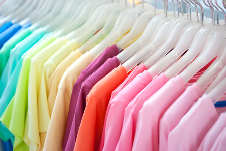 Colorful t-shirt on hangers photo