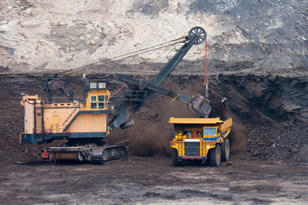 coal truck: big mining truck unload coal Stock Photo
