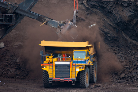 mining: big mining truck unload coal Stock Photo