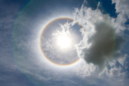 Sun with circular rainbow - sun halo 스톡 콘텐츠