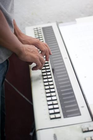 Printer checking a print run at table photo