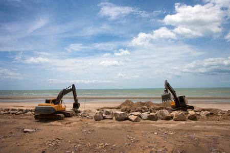 sand quarry: excavator machine doing earthmoving work at sand quarry