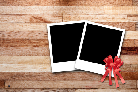 Blank photo frames on wood background photo