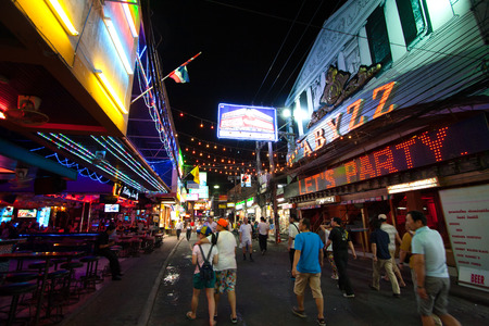 PATTAYA, THAILAND - JANUARY 1, 2006: multicolored neon signs in the heart of the Walking Street of Pattaya. The street is closed to the traffic after 6pm and stays crowded until late in the night.