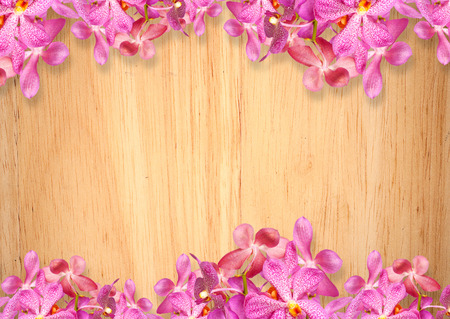 Old wooden background with pink Orchid flowers frame photo