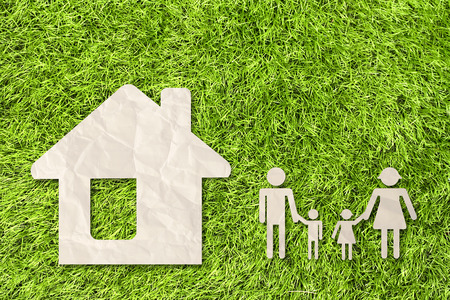 home care: House on green grass background