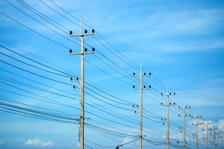 high powered: Power lines on the blue sky