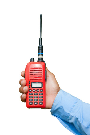 Red portable radio transceiver in hand isolated on white photo