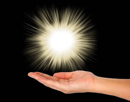praise and worship: glowing lights on hand Stock Photo