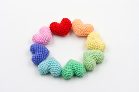 Colorful Yarn hearts on white background photo