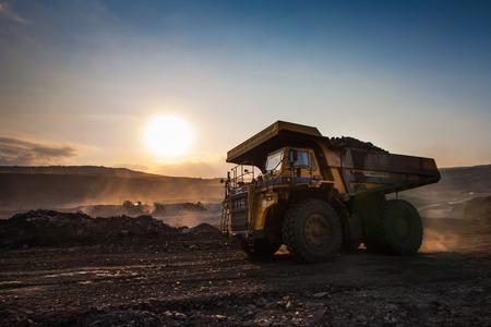 LAMPANG, THAILAND - DEC 29: coal-preparation plant. Big yellow mining truck at work site coal transportation, December, 29, 2014 in Lampang, Thailand