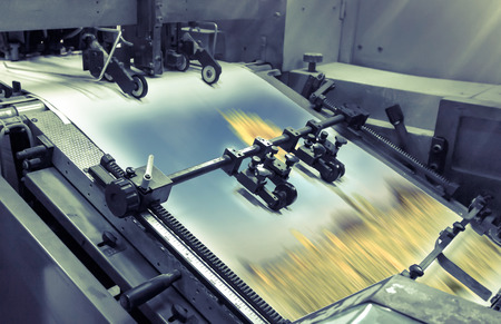 printing: process in a modern printing house - vintage filter Stock Photo