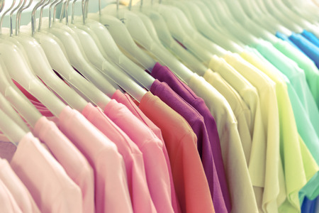 vintage filter of Colorful t-shirt on hangers