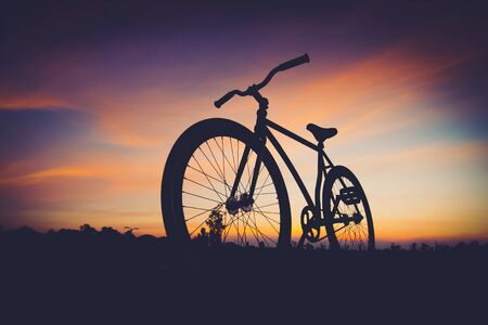 effect sunset: silhouette bicycle in sunset - vintage filter effect Stock Photo