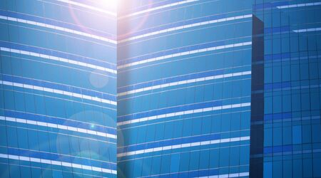 building loan: Close up of a modern business building and lens flare in blue color tone Stock Photo