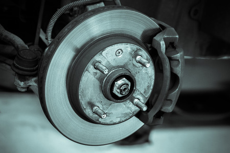safety check: brake disk and detail of the wheel hub - black and white filter effect
