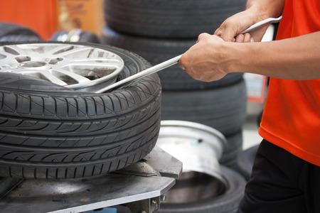 Close-up of Mechanic changing car tire closeup
