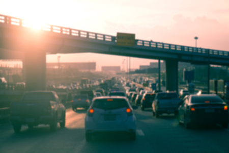 multiple lane highway: Blur of Car traffic against the sunset background. - Vintage filter effect Stock Photo
