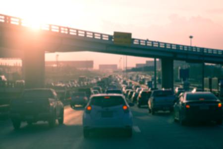 Blur of Car traffic against the sunset background. - Vintage filter effect Zdjęcie Seryjne