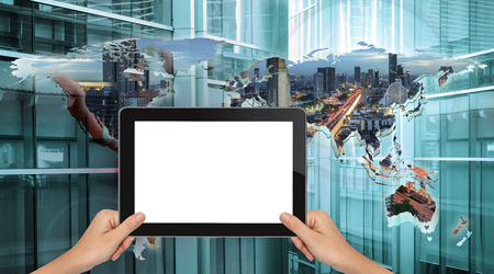 horizontal position: Hand shows black tablet in horizontal position on technology background - mockup template