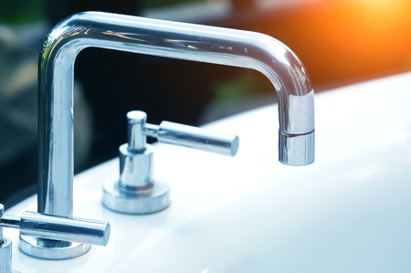 sink: high spout faucet in front on sink Stock Photo