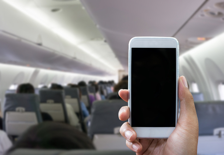 Man use your phone in airplane blurred background - mockup template
