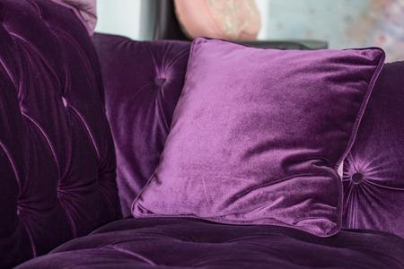 pillow: One Purple velvet pillows on the sofa Stock Photo