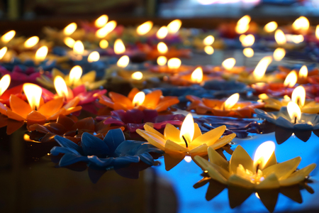Many of colourful Floating candles Imagens