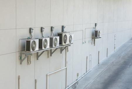 compressor: Air conditioning compressor in white wall - Air compressor or compressor machine Stock Photo
