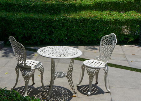 two chairs: White table and Two chairs in the park