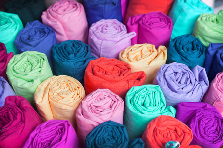 fabric roll: Colorful fabric roll. fabric Industry popular in many countries. You Can use this fabric background for your fabric theme and concept design Stock Photo