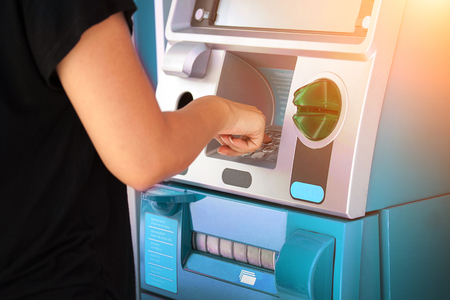 pressing password number on ATM machine - Online banking business concept. 免版税图像